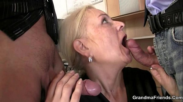 Mature wife serving two cocks